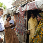 Bill Gates meeting with residents of Ujarion slum in Lucknow, Uttar Pradesh, India on May 30, 2012.