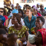 Melinda Gates listens with a group at a health post in Dakar, Senegal on July 9, 2012.